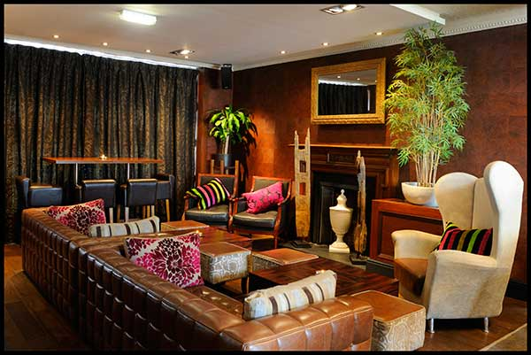 The colour scheme is warm and cosy and the dining room is for Room interior design edinburgh